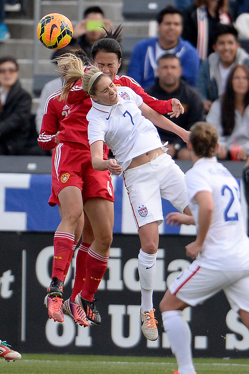 . Morgan Brian (7) of the U.S.A. heads the ball away from Zeng Ying (6) of China during the first half of women\'s soccer action. Dick\'s Sporting Goods Park on Sunday, April 6, 2014. (Photo by AAron Ontiveroz/The Denver Post)