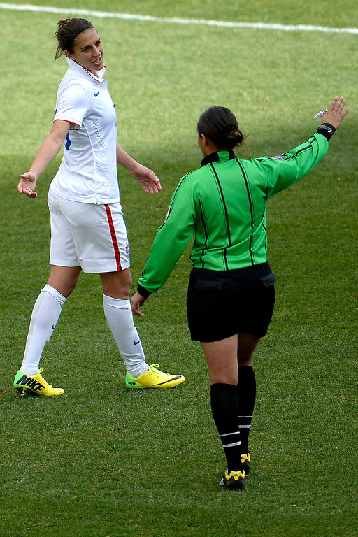 . Carli Lloyd (10) of the U.S.A. contests a call after wiping out Ren Guixin (23) of China during the second half of the U.S.A.\'s 2-0 win. Dick\'s Sporting Goods Park on Sunday, April 6, 2014. (Photo by AAron Ontiveroz/The Denver Post)