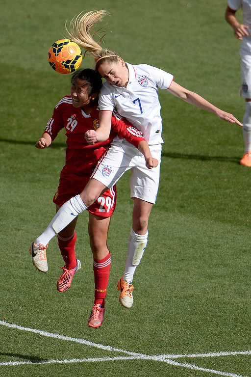 . Morgan Brian (7) of the U.S.A. heads the ball away from Yang Li (29) of China during the second half of the U.S.A.\'s 2-0 win. Dick\'s Sporting Goods Park on Sunday, April 6, 2014. (Photo by AAron Ontiveroz/The Denver Post)