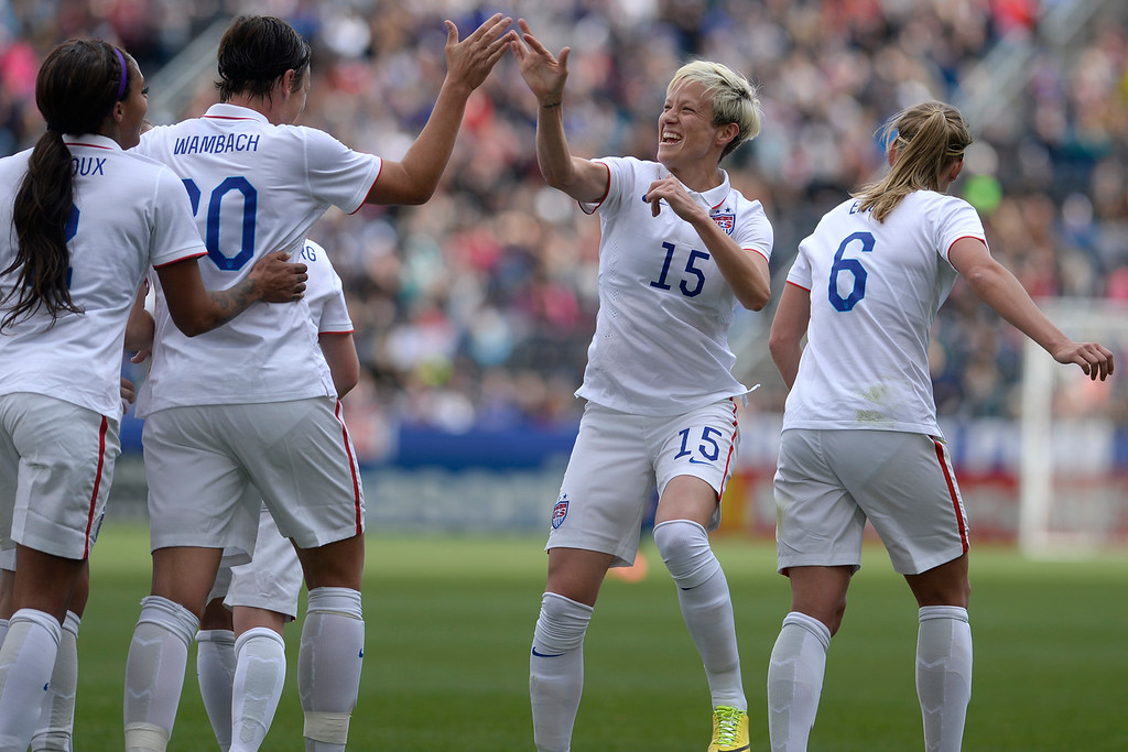 . Megan Rapinoe (15) of the U.S.A. high fives teammate Abby Wambach (20) after scoring her team\'s second goal against China during team U.S.A.\'s 2-0 win. Dick\'s Sporting Goods Park on Sunday, April 6, 2014. (Photo by AAron Ontiveroz/The Denver Post)