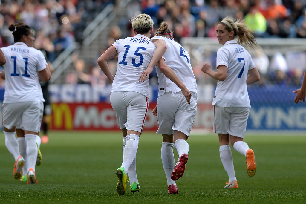 . Megan Rapinoe (15) of the U.S.A. celebrates her 2-0 goal against China with teammate Becky Sauerbrunn (4) during team U.S.A.\'s 2-0 win. Dick\'s Sporting Goods Park on Sunday, April 6, 2014. (Photo by AAron Ontiveroz/The Denver Post)