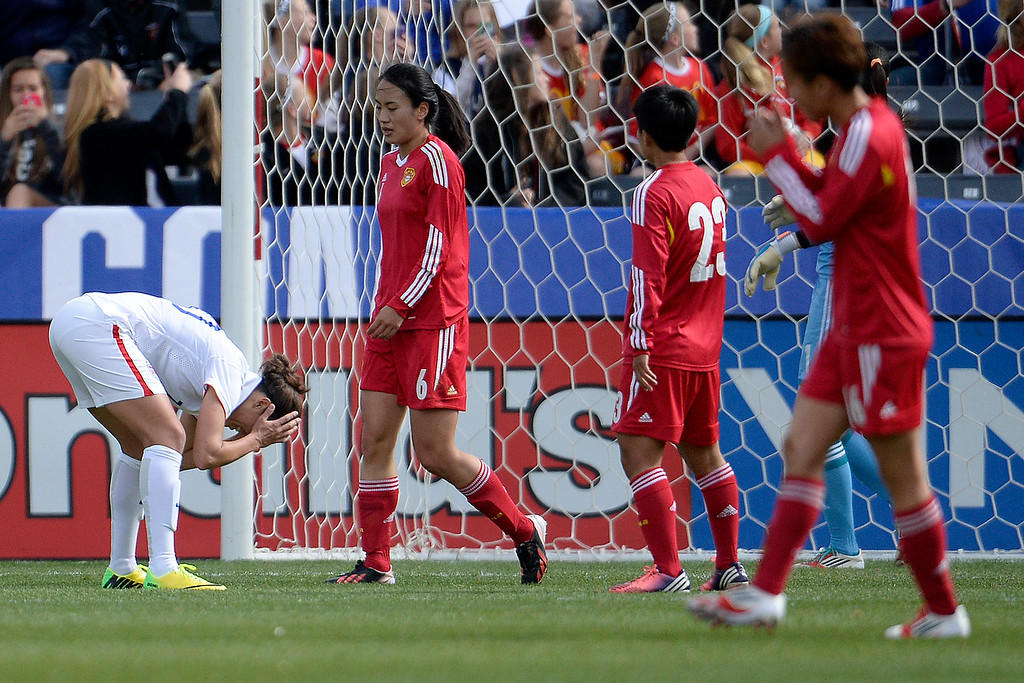 . Carli Lloyd (10) of the U.S.A. reacts to narrowly missing a goal against China during the first half of women\'s soccer action. Dick\'s Sporting Goods Park on Sunday, April 6, 2014. (Photo by AAron Ontiveroz/The Denver Post)