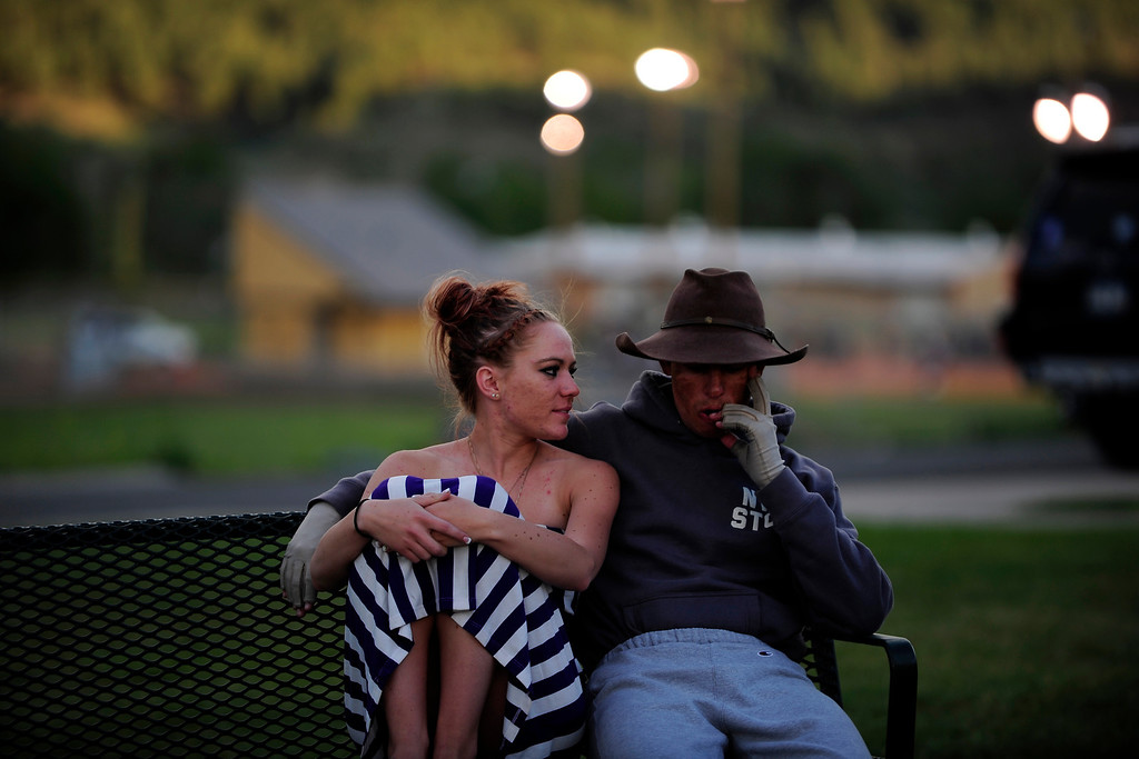 . PAGOSA SPRINGS, CO. - JUNE 6: Michael Martinez sits with his girlfiend  Kaitlin Mastin outside Pagosa Springs High School, May 6, 2013. Martinez, working as a clinician at the Wrestle the World wrestling camp taking place at the school, takes a break from work because he tires easily due to his severe burns.  (Photo By Mahala Gaylord/The Denver Post)