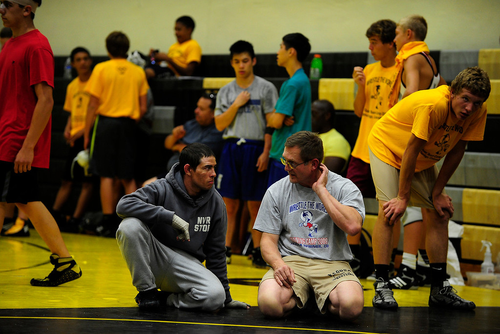 . PAGOSA SPRINGS, CO. - JUNE 6: Michael Martinez talks with his high school wrestling coach Dan Janowsky at Pagosa Springs high school during the Wrestle the World wrestling camp on June 6, 2013. Janowsky attributes Martinez\' fast recovery to his wresting mentality and toughness. The two-time state wrestling champion at Pagosa Springs High School and three-time Western Wrestling Conference champion at Wyoming, survived a propane explosion on April 2, 2013, that blew up a camper on his parents ranch. Eighty percent of his body was covered in 2nd and 3rd degree burns. (Photo By Mahala Gaylord/The Denver Post)