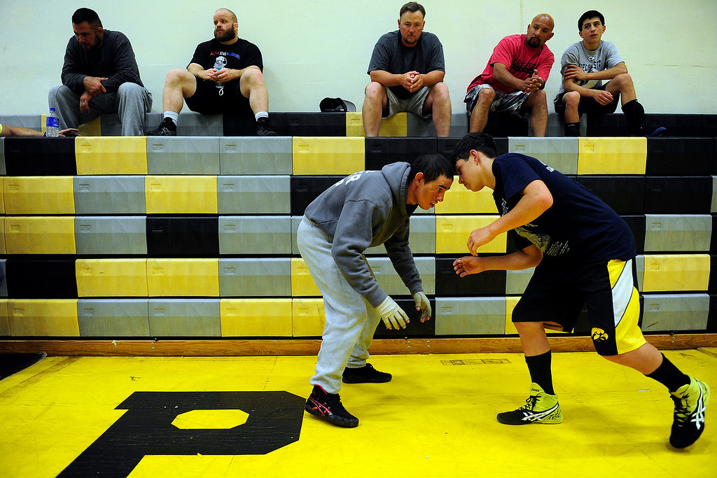 . PAGOSA SPRINGS, CO. - MAY 6: Michael Martinez, 27, works with Dalton Lucero, 14, on his stance and keeping his arm down. Martinez worked as a clinician at the Wrestle the World wrestling camp in Pagosa Springs, CO.  (Photo By Mahala Gaylord/The Denver Post)