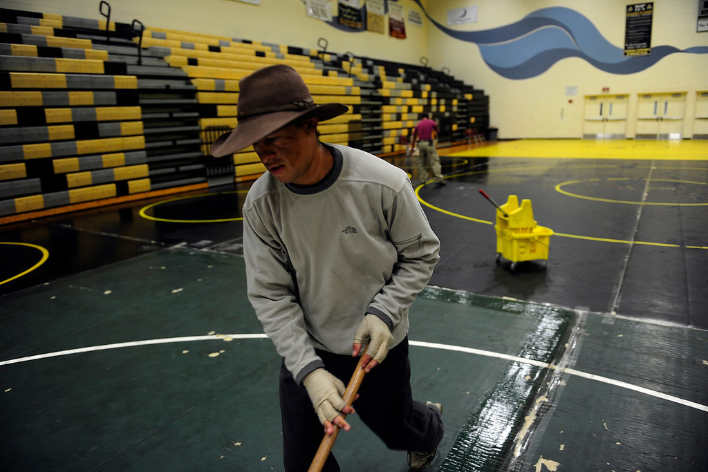 . PAGOSA SPRINGS, CO. - JUNE 7: Michael Martinez helps mop the mats at the Wrestle the World wrestling camp in Pagosa Springs, CO May 7, 2013. Martinez attended the camp during his high school wrestling years and is now a clinician, helping other young wrestlers hone their skills. (Photo By Mahala Gaylord/The Denver Post)