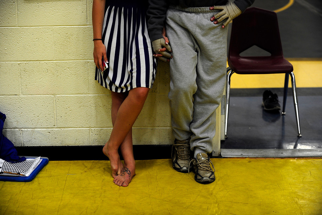 . PAGOSA SPRINGS, CO. - JUNE 6: Michael Martinez holds hands with his girlfiend  Kaitlin Mastin at Wrestle the World wrestling camp at Pagosa Springs High School, May 6, 2013. The two started dating two months before Martinez was caught in a propane explosion on April 2, 2013, that blew up a camper on his parents ranch. Eighty percent of his body was covered in 2nd and 3rd degree burns. (Photo By Mahala Gaylord/The Denver Post)