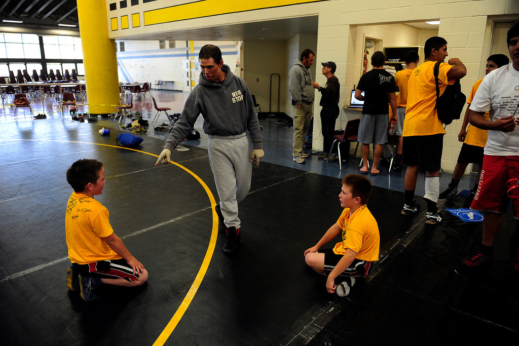 . PAGOSA SPRINGS, CO. - JUNE 6: Michael Martinez coaches brothers Jacob Ramsted, left, and Tyler Ramsted at the Wrestle the World wrestling camp in Pagosa Springs, CO on June 6, 2013. Martinez, once a camper himself now works as a clinician for the camp. (Photo By Mahala Gaylord/The Denver Post)