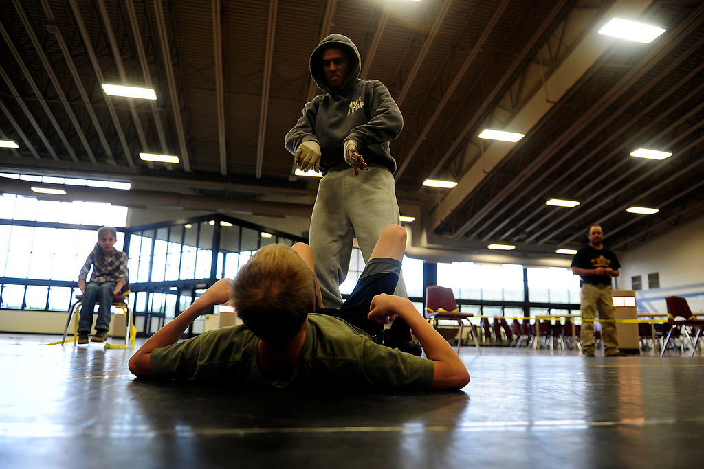 . PAGOSA SPRINGS, CO. - MAY 6: Michael Martinez talks about moves with Trevor Bryant 14, a wrestler for Pagosa Springs High School on May 6, 2013 at the Wrestle the World wrestling camp.  (Photo By Mahala Gaylord/The Denver Post)