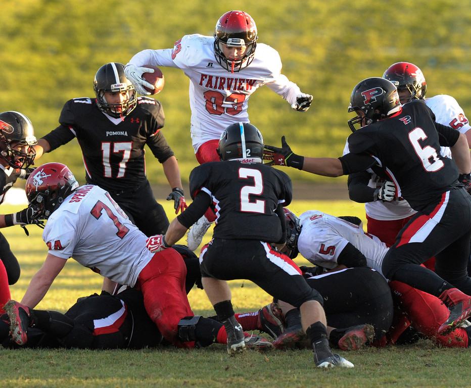 . ARVADA, CO. - OCTOBER 18: Fairview ball carrier Sam Martin (83) hurdled the line in the third quarter. The Fairview High School football team remained undefeated with a 33-30 win over Pomona Friday night, October 18, 2013. The Knights kicked a field goal as time expired in the fourth quarter. Photo By Karl Gehring/The Denver Post