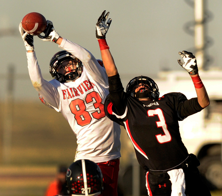 . ARVADA, CO. - OCTOBER 18: Fairview receiver Sam Martin (83) hauled down a catch behind Pomona defensive back Kyle Kounnas (3) in the second quarter. The Pomona High School football team hosted Fairview Friday night, October 18, 2013. Photo By Karl Gehring/The Denver Post