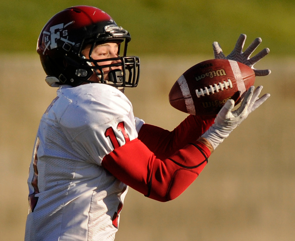 . ARVADA, CO. - OCTOBER 18: Fairview receiver Cameron Frazier (11) hauled in a pass in the first half. The Pomona High School football team hosted Fairview Friday night, October 18, 2013. Photo By Karl Gehring/The Denver Post