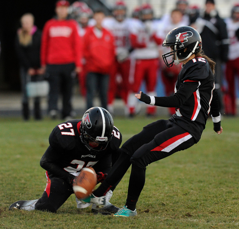 . ARVADA, CO. - OCTOBER 18: Pomona kicker Ally Thimsen (12) tied the game with an extra point in the fourth quarter. The Fairview High School football team remained undefeated with a 33-30 win over Pomona Friday night, October 18, 2013. The Knights kicked a field goal as time expired in the fourth quarter. Photo By Karl Gehring/The Denver Post