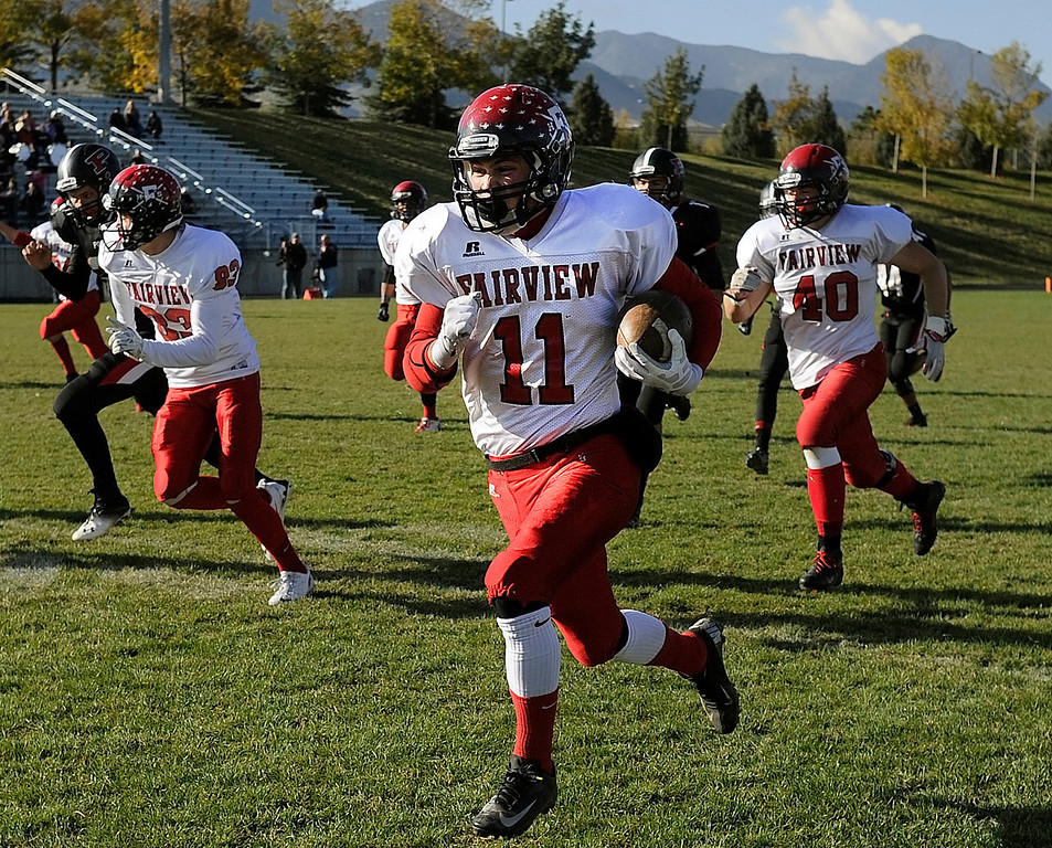 . ARVADA, CO. - OCTOBER 18: Fairview kick returner Cameron Frazier scored a touchdown on the opening play of the game. The Fairview High School football team remained undefeated with a 33-30 win over Pomona Friday night, October 18, 2013. The Knights kicked a field goal as time expired in the fourth quarter. Photo By Karl Gehring/The Denver Post