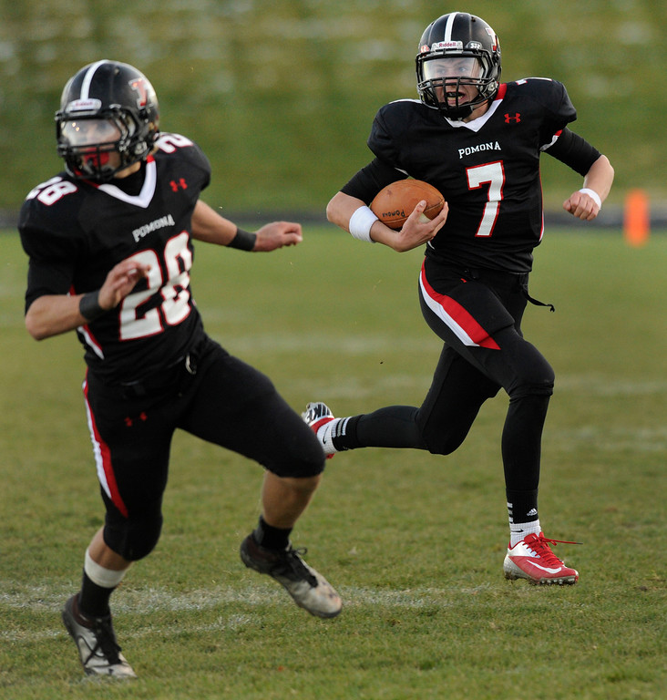 . ARVADA, CO. - OCTOBER 18: Pomona quarterback Justin Robets (7) set up the Panther\'s final touchdown with a run in the fourth quarter. The Fairview High School football team remained undefeated with a 33-30 win over Pomona Friday night, October 18, 2013. The Knights kicked a field goal as time expired in the fourth quarter. Photo By Karl Gehring/The Denver Post
