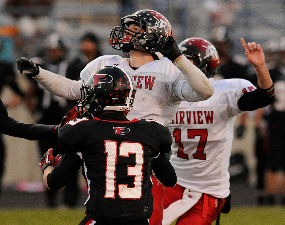 . ARVADA, CO. - OCTOBER 18: Fairview kicker Jonathan Swartzwelter (7) reacts as he watched his 27-yard effort sail through the uprights on the last play of the game to secure a win Friday night. The Fairview High School football team remained undefeated with a 33-30 win over Pomona Friday night, October 18, 2013. The Knights kicked a field goal as time expired in the fourth quarter. Photo By Karl Gehring/The Denver Post