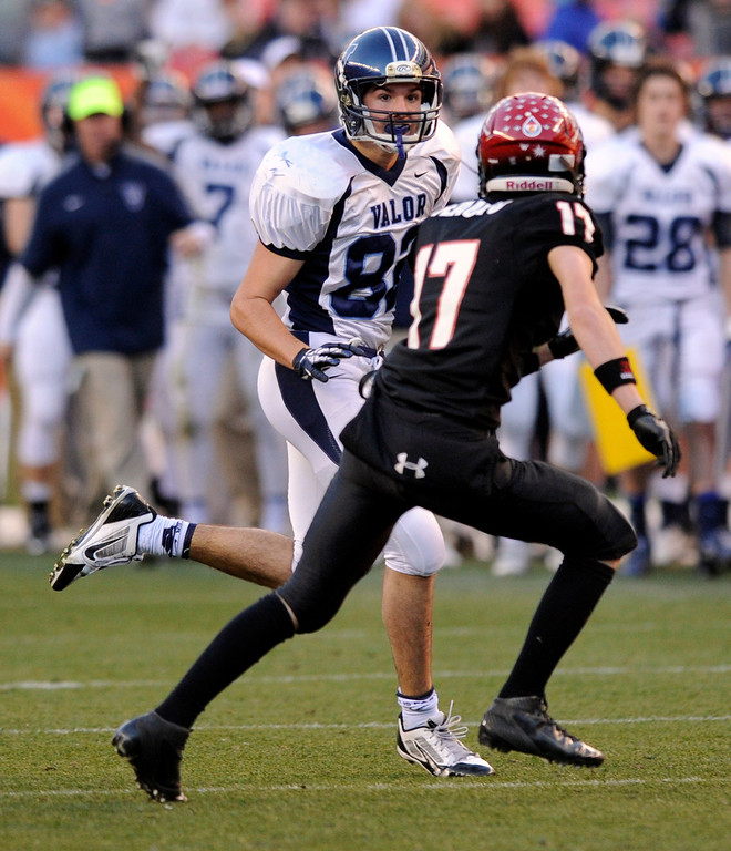 . Valor wide receiver Booker Schelhaas (82) tried to get past Fairview defensive back Johnny Feauto (17) after a catch in the first half.  The Valor Christian football team took on Fairview in the 5A championship game Saturday, November 30, 2013. Photo By Karl Gehring/The Denver Post