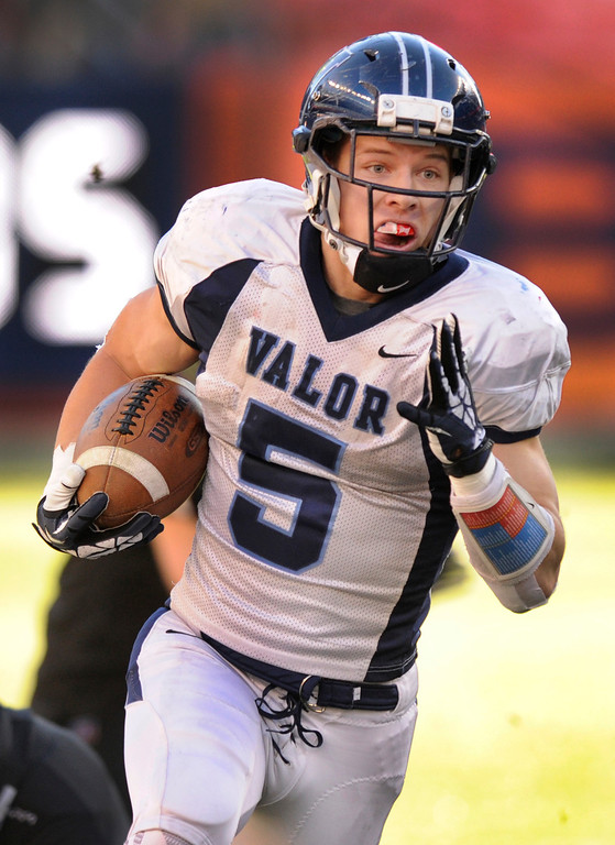 . Eagles\' running back Christian McCaffrey (5) had a clear shot to the end zone after making two Fairview defenders miss him in the first quarter. The Valor Christian football team took on Fairview in the 5A championship game Saturday, November 30, 2013. Photo By Karl Gehring/The Denver Post