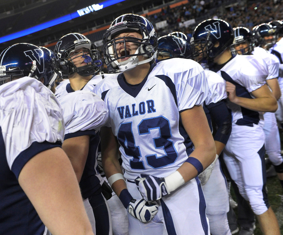 . Eagles\' linebacker Sam Saddoris (43) whooped it up at the end of the game. The Valor Christian football team rolled past Fairview 56-16 in the 5A championship game Saturday, November 30, 2013. Photo By Karl Gehring/The Denver Post