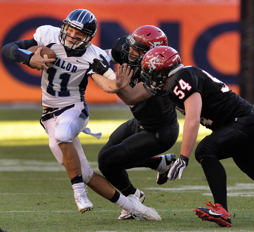 . Valor quarterback A.J. Cecil (11) called his own number for a gain in the first half. The Eagles\' linebacker David Corral (8)  recovered the fumble.  The Valor Christian football team took on Fairview in the 5A championship game Saturday, November 30, 2013. Photo By Karl Gehring/The Denver Post