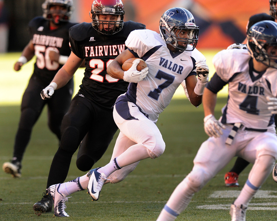 . Eagles\' wide receiver Eric Lee Jr. made a cut back against the grain on a first quarter reverse that netted the first points of the game.  The Valor Christian football team rolled past Fairview 56-16 in the 5A championship game Saturday, November 30, 2013. Photo By Karl Gehring/The Denver Post