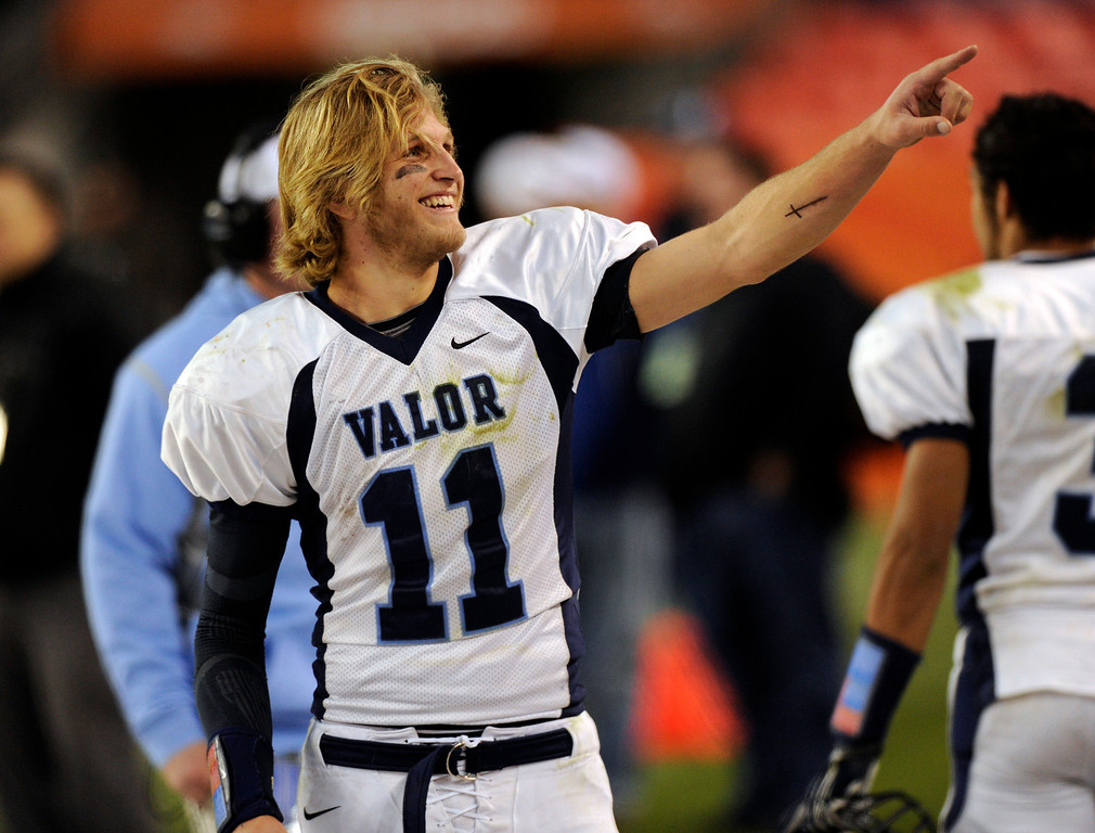 . Valor quarterback A.J. Cecil pointed to the student section. The Valor Christian football team rolled past Fairview 56-16 in the 5A championship game Saturday, November 30, 2013. Photo By Karl Gehring/The Denver Post