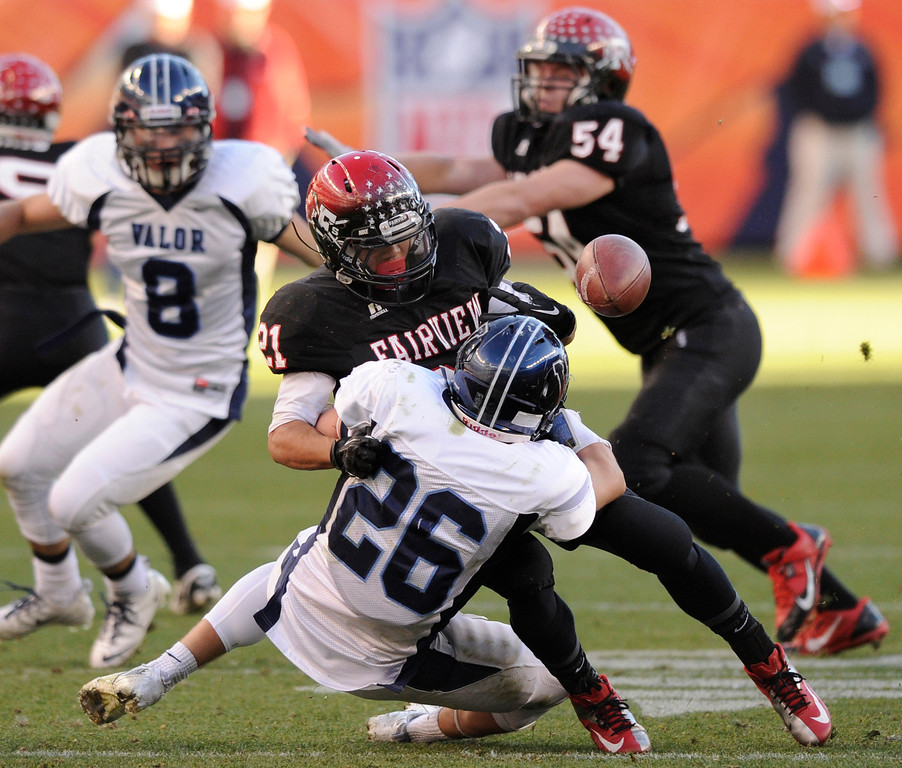 . Fairview ball carrier Connor Twist (21) coughed up the ball in the first quarter. The Eagles recovered the fumble.  The Valor Christian football team took on Fairview in the 5A championship game Saturday, November 30, 2013. Photo By Karl Gehring/The Denver Post