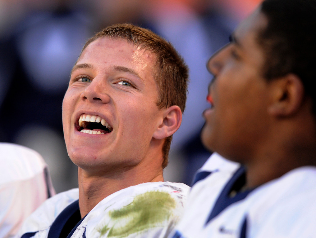 . Valor running back Christian McCaffrey smiled on the bench after a touchdown in the second quarter. The Valor Christian football team took on Fairview in the 5A championship game Saturday, November 30, 2013. Photo By Karl Gehring/The Denver Post