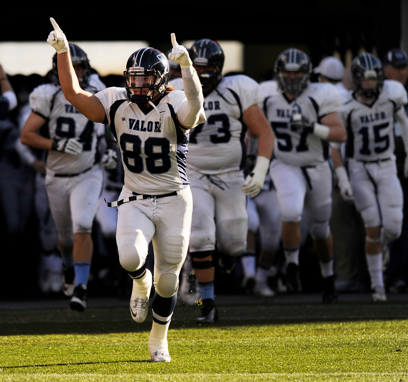 . Eagles\' senior tight end Clarke Cooper (88) led the team onto the field for the first half. The Valor Christian football team took on Fairview in the 5A championship game Saturday, November 30, 2013. Photo By Karl Gehring/The Denver Post