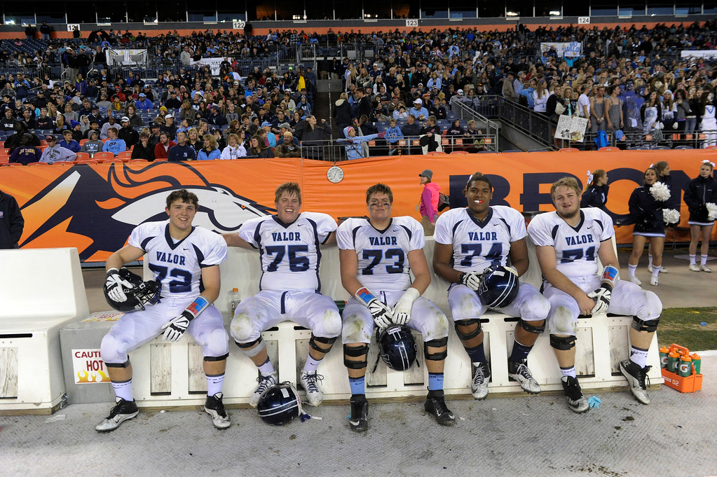 . The Valor starting offensive line, all of them seniors, took a well-deserved break in the second half. From left are Sam Kozan (72), Alec Ruth (75), Ryan Cummings (73) Isiah Holland (74), and Cody Bratten (71). The Valor Christian football team rolled past Fairview 56-16 in the 5A championship game Saturday, November 30, 2013. Photo By Karl Gehring/The Denver Post