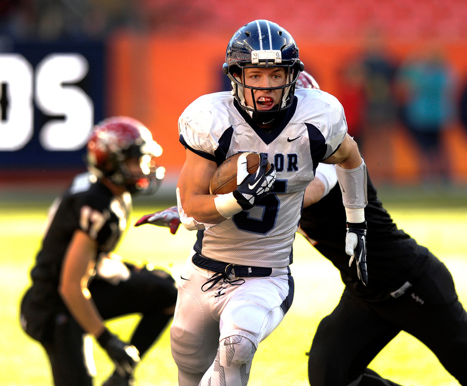 . Eagles\' running back Christian McCaffrey (5) had a clear shot to the end zone after making two Fairview defenders miss in the first quarter. The Valor Christian football team took on Fairview in the 5A championship game Saturday, November 30, 2013. Photo By Karl Gehring/The Denver Post