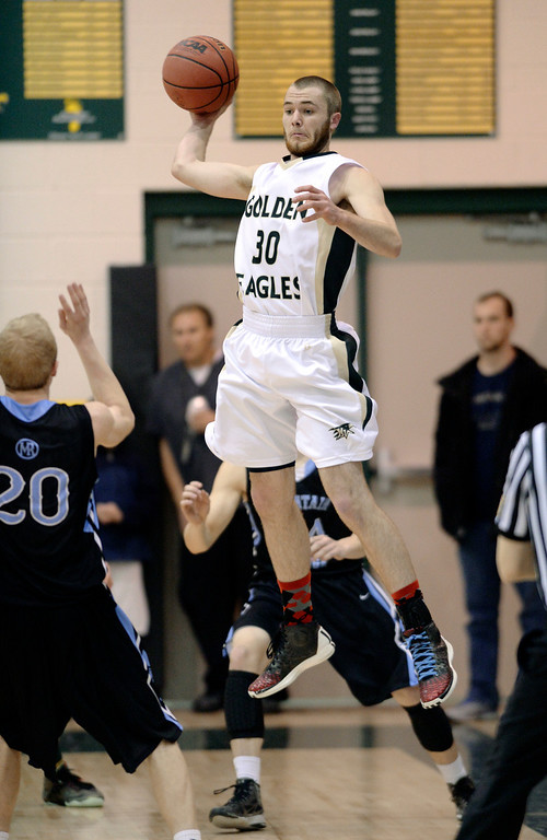 . Golden Eagles\' junior guard Raymond Beresford (30) looked to make a pass in the fourth quarter. The Mountain Vista boy\'s basketball team defeated Mountain Range 78-56 Saturday night, March 1, 2014. Photo By Karl Gehring/The Denver Post