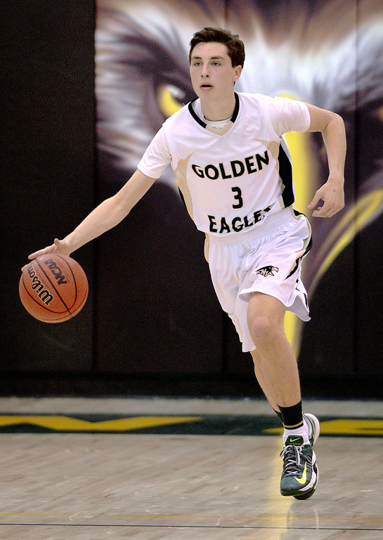 . Golden Eagles\' senior guard Jake Pemberton started the ball down the court Saturday night.  The Mountain Vista boy\'s basketball team defeated Mountain Range 78-56 Saturday night, March 1, 2014. Photo By Karl Gehring/The Denver Post