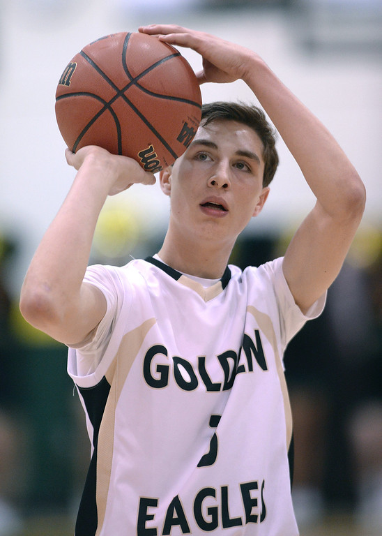 . Golden Eagles\' senior guard Jake Pemberton (3) shot from the foul line in the first half. The Mountain Vista boy\'s basketball team defeated Mountain Range 78-56 Saturday night, March 1, 2014. Photo By Karl Gehring/The Denver Post