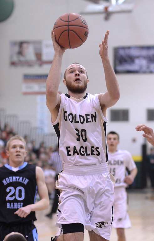 . Golden Eagles\' guard Raymond Beresford (30) found a clear path the basket in the first half. The Mountain Vista boy\'s basketball team defeated Mountain Range 78-56 Saturday night, March 1, 2014. Photo By Karl Gehring/The Denver Post