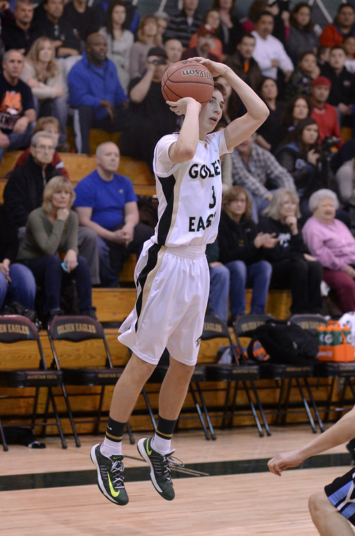 . Golden Eagles\' senior guard Jake Pemberton (3) launched a three-point shot in the first half. The Mountain Vista boy\'s basketball team defeated Mountain Range 78-56 Saturday night, March 1, 2014. Photo By Karl Gehring/The Denver Post