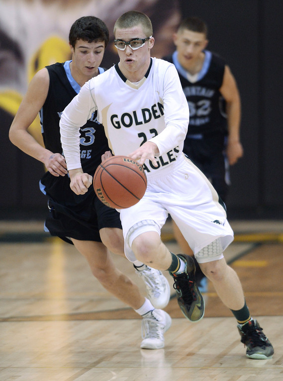 . Golden Eagles\' junior guard Brady Subart (23) worked the ball up the court in the second half. The Mountain Vista boy\'s basketball team defeated Mountain Range 78-56 Saturday night, March 1, 2014. Photo By Karl Gehring/The Denver Post
