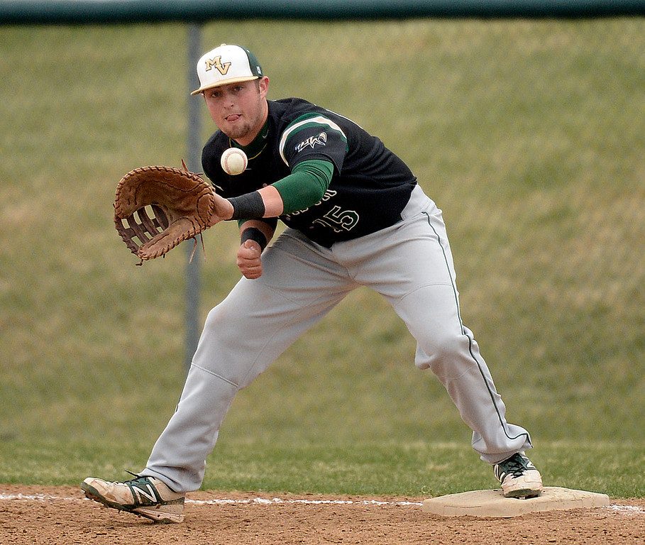 . Mountain Vista first-baseman Will Dixon took the throw to retire ThunderRidge batter Jake Eissler in the second inning. The Mountain Vista High School baseball team blanked ThunderRidge 3-0 Wednesday afternoon, April 16, 2014. (Photo by Karl Gehring/The Denver Post)