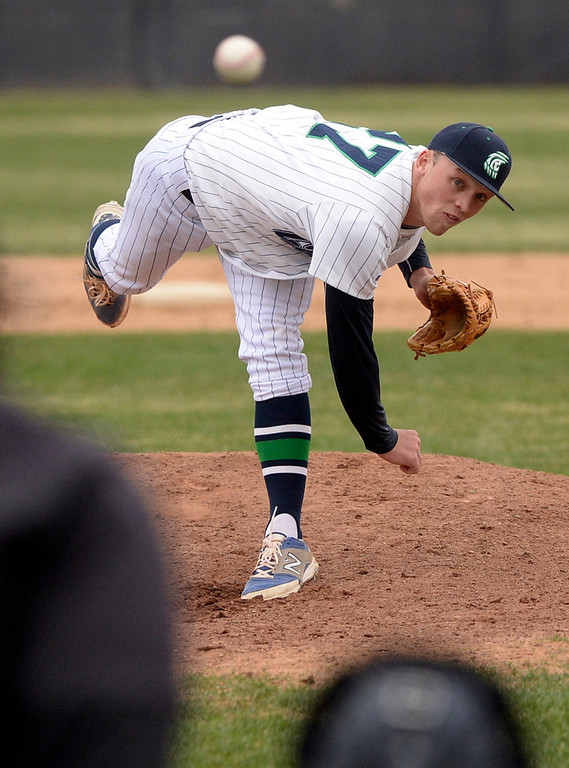 . ThunderRidge pitcher AJ Jones delivered to the plate. The Mountain Vista High School baseball team blanked ThunderRidge 3-0 Wednesday afternoon, April 16, 2014. (Photo by Karl Gehring/The Denver Post)