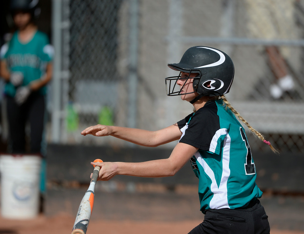 . Westminster High School outfielder, Natalie Taylor, hits a single to the outfield in the third inning against Mountain Range High School during the championship game of the inaugural 2014 King of the Mountain 5A softball tournament at Mountain Range High School Saturday afternoon, August 30, 2014. (Photo By Andy Cross / The Denver Post)