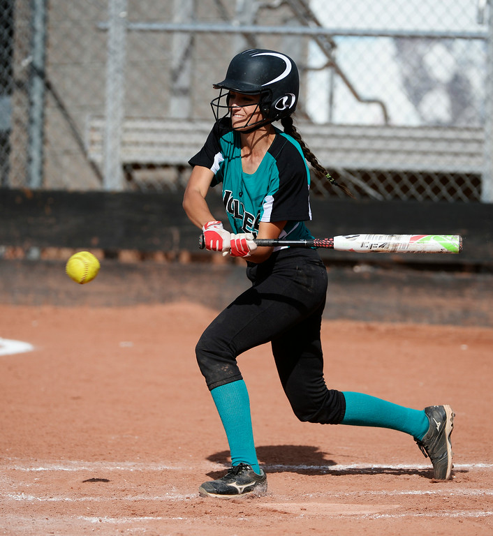 . Westminster High School infielder, Nicole Taylor, gets a hit, out at first, but advances a runner in the third inning against Mountain Range High School during the championship game of the inaugural 2014 King of the Mountain 5A softball tournament at Mountain Range High School Saturday afternoon, August 30, 2014. (Photo By Andy Cross / The Denver Post)