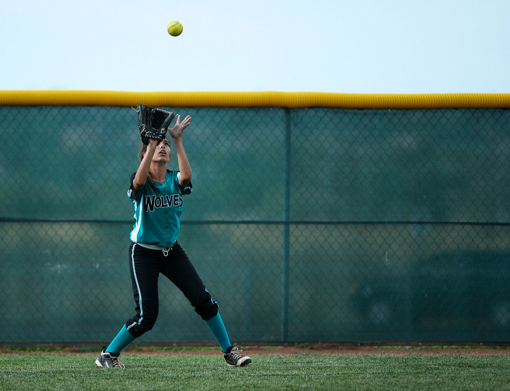 . Westminster High School outfielder, Angel Micciulli makes a catch for an out against Mountain Range High School during the championship game of the inaugural 2014 King of the Mountain 5A softball tournament at Mountain Range High School Saturday afternoon, August 30, 2014. (Photo By Andy Cross / The Denver Post)
