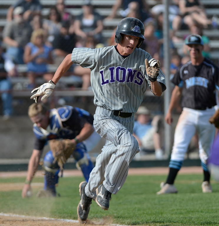 . DENVER, CO - MAY 25:  Justin Dennis, Mountain View, laid down a bunt to advance a runner to second, but was thrown out at first in the 7th inning during the 2013 4A Colorado State Championship game at All City Stadium. Mountain View went on to win in extra innings 7-6. (Photo By Andy Cross/The Denver Post)