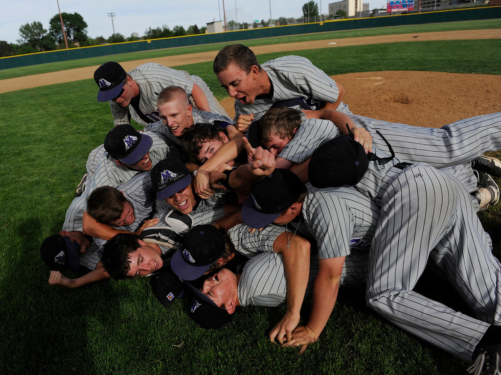 . DENVER, CO - MAY 25:  The Mountain View Mt. Lions celebrate after defeating the Pueblo West Cyclones to win the 2013 4A Colorado State Championship 7-6 in extra innings Saturday May 25, 2013 at All City Stadium.  (Photo By Andy Cross/The Denver Post)