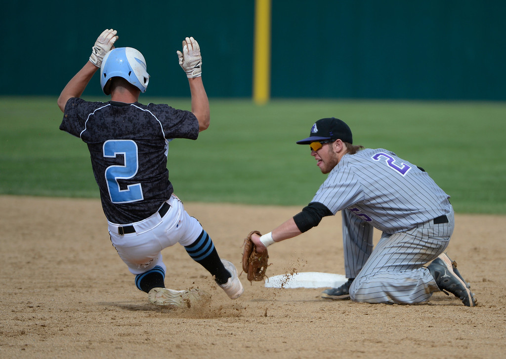 . DENVER, CO - MAY 25:  Hunter Porterfield, right, Mountain View, tags Chase Trujillo, Pueblo West, out at second on a steal in the third inning of play during the 2013 4A Colorado State Championship game at All City Stadium. Mountain View went on to win in extra innings 7-6. (Photo By Andy Cross/The Denver Post)