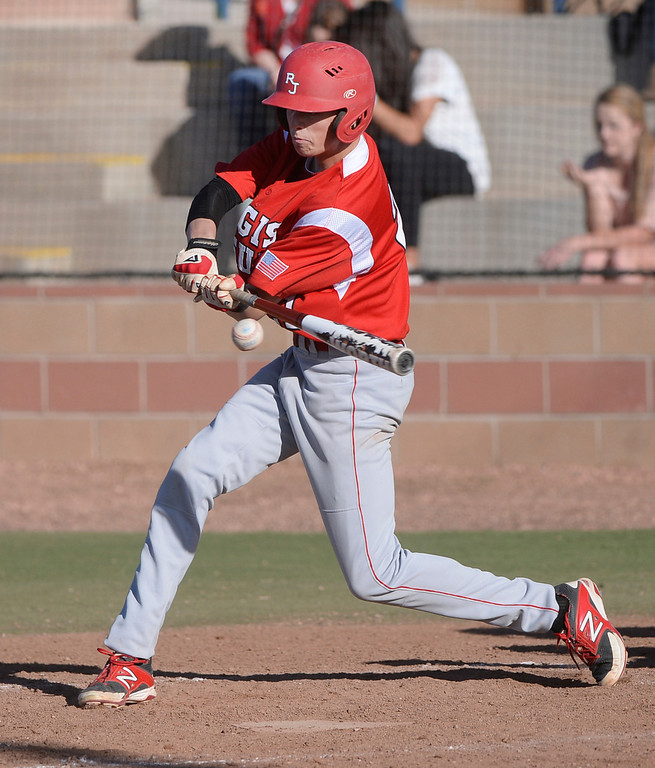 . Regis junior Aidan Cameron grounded out in the fourth inning but got his revenge in the sixth inning with a grand slam homer. The Regis Jesuit baseball team defeated Rock Canyon 10-1 Friday afternoon, April 11, 2014.  (Photo by Karl Gehring/The Denver Post)
