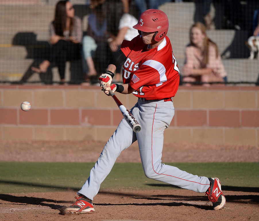 . Raiders batter Aidan Cameron blasted a sixth-inning grand slam home run over the right field fence. The Regis Jesuit baseball team defeated Rock Canyon 10-1 Friday afternoon, April 11, 2014.  (Photo by Karl Gehring/The Denver Post)