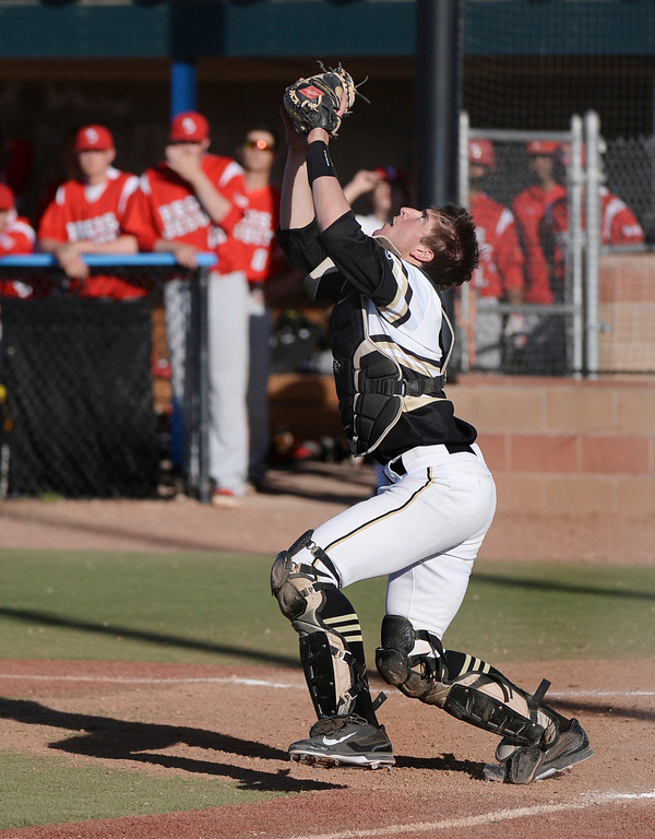 . Rock Canyon catcher Andrew Nicklanovich got underneath a pop up in the sixth inning. The Regis Jesuit baseball team defeated Rock Canyon 10-1 Friday afternoon, April 11, 2014.  (Photo by Karl Gehring/The Denver Post)