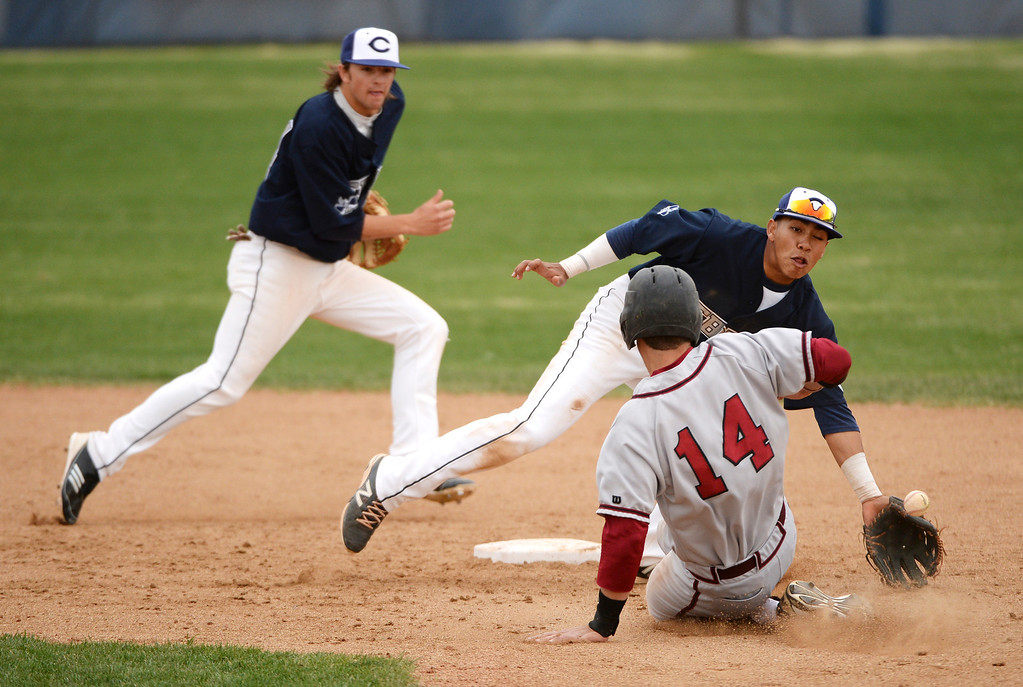 . Jacob Falbo of Chatfield High School (14) steals second base while Columbine\'s Donny Ortiz as  Austin Anderson (24), left, runs in for support during the game at Columbine High School.   (Photo by Hyoung Chang/The Denver Post)
