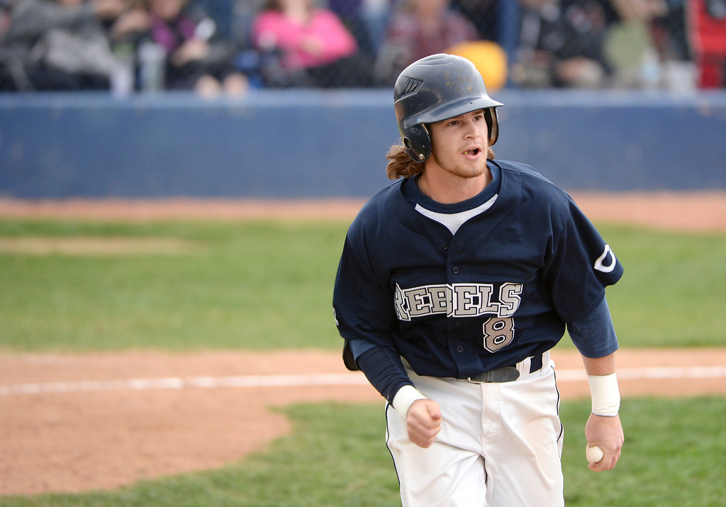 . Tyler Mohr of Columbine High School (24) watches his grand slam home run  during the game against Chatfield High School at Columbine High School. (Photo by Hyoung Chang/The Denver Post)